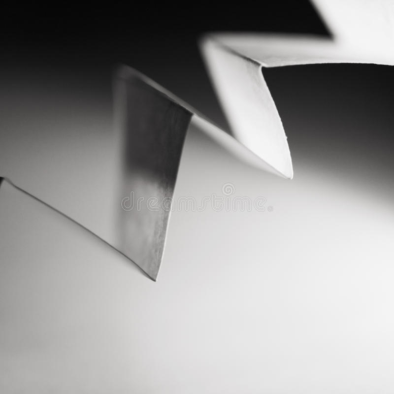 Macro, abstract, black and white picture of a zig-zag paper. On paper background stock photo