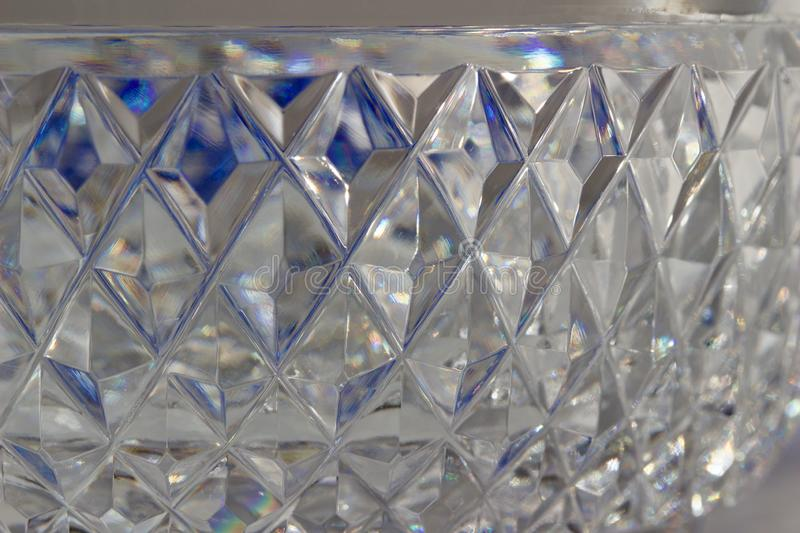 Macro abstract texture background of beautiful hand cut lead crystal glass with diamond cut facets. Reflecting brilliant shimmer royalty free stock image
