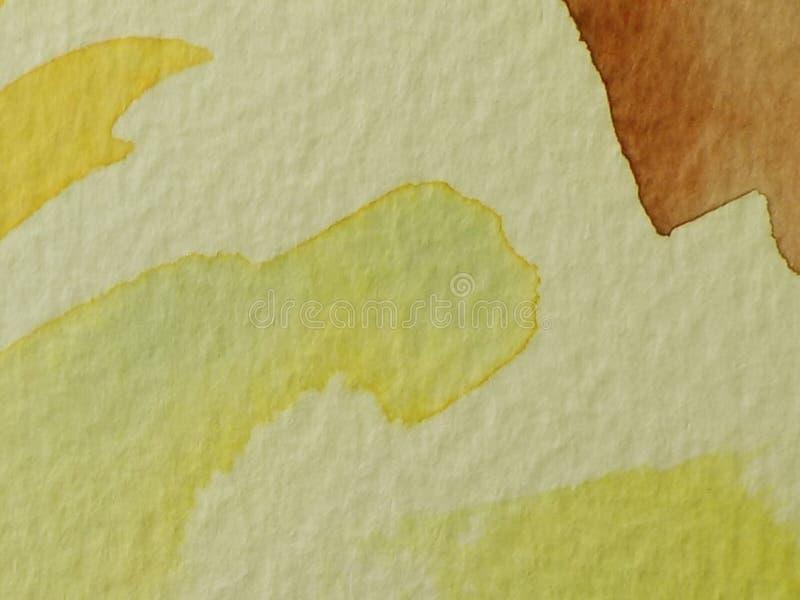 Macro amarilla y marrón del Libro Blanco de los movimientos del cepillo del watercolour imagen de archivo