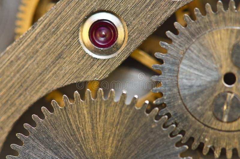 Macro. Background with metal cogwheels clockwork. Conceptual photo for your successful business design or other successful. Variants royalty free stock images