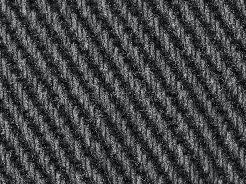 Macro bagout de fond de texture de denim de jeans de plan rapproché noir de tissu photos stock