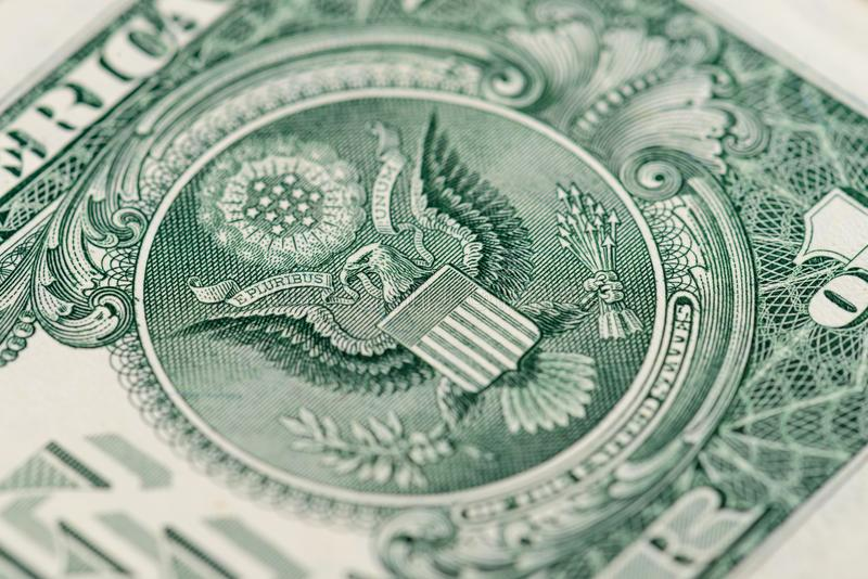 Macro banconota del frammento un dollaro americano immagini stock