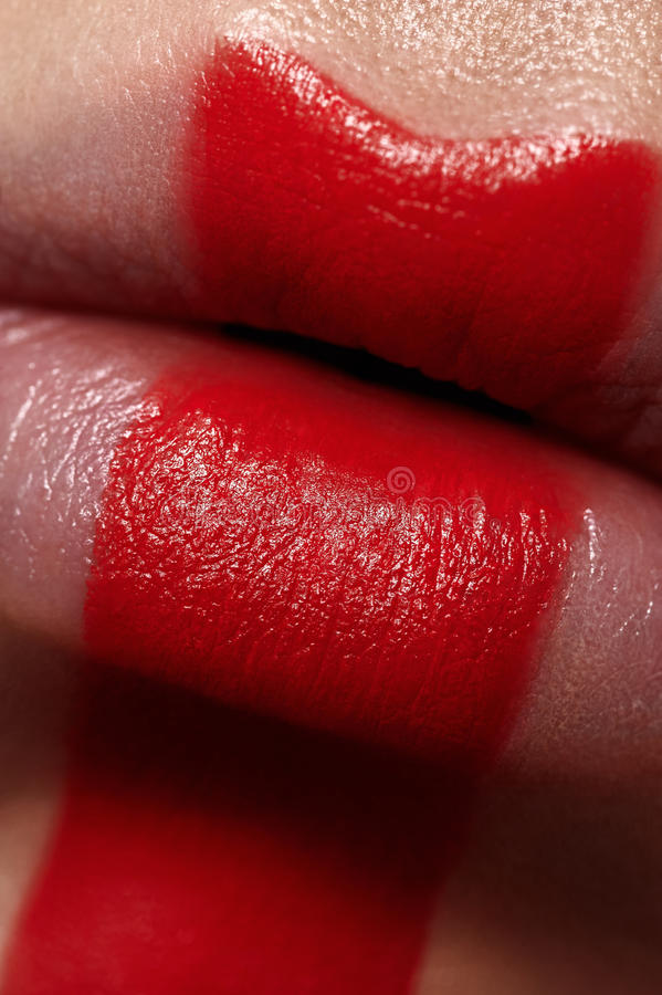 Macro beauty Woman`s Lips with red Paint stock photography