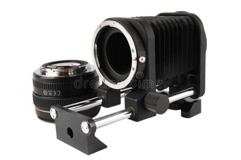 Macro bellows and lens. Macro bellows and 50mm lens with white background stock photography