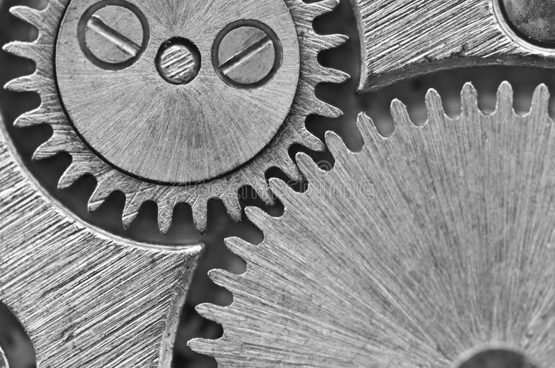 Macro. Black and white background. Metal close-up background of. An old clock mechanism of cogwheels. Conceptual photo for your successful business design or stock photos