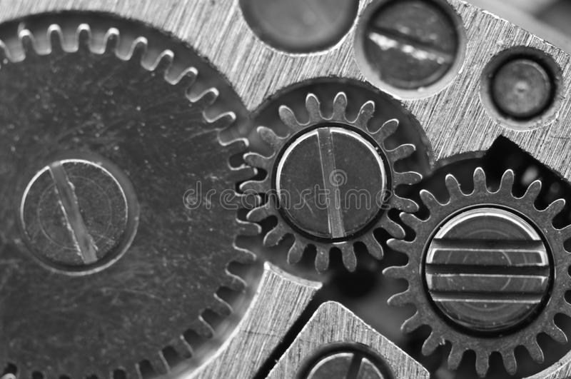 Macro. Black and white background. Metal close-up background of. An old clock mechanism of cogwheels. Conceptual photo for your successful business design or stock image