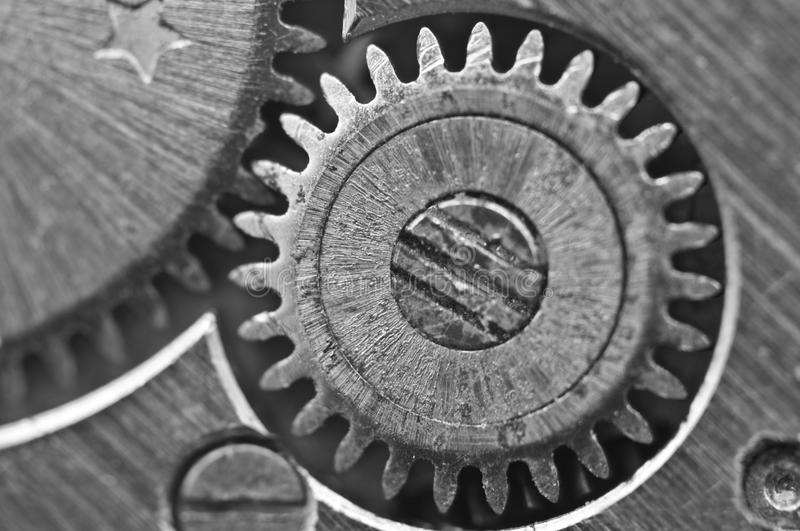 Macro, Black and white background with metal cogwheels clockwork. Macro. Black and white background with metal cogwheels close-up clockwork. Conceptual photo for stock image
