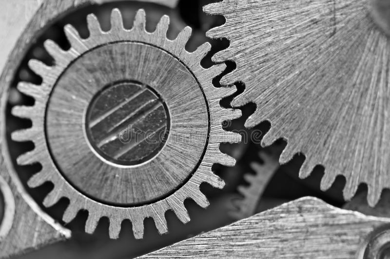 Macro. Black and white background with metal cogwheels close-up. Clockwork. Conceptual photo for your successful business design or other successful variants royalty free stock image