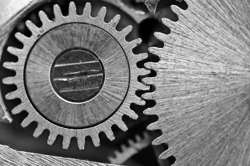 Macro. Black and white background with metal cogwheels close-up. Clockwork. Conceptual photo for your successful business design or other successful variants stock photography