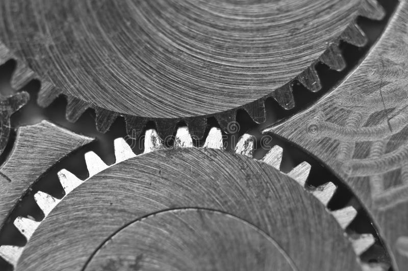 Macro, Black and white background with metal cogwheels clockwork. Macro. Black and white background with metal cogwheels close-up clockwork. Conceptual photo for stock photography