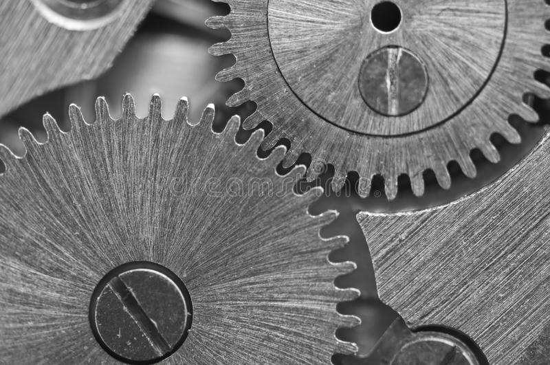 Macro. Black and white background with metal cogwheels close-up. Clockwork. Conceptual photo for your successful business design or other successful variants stock image