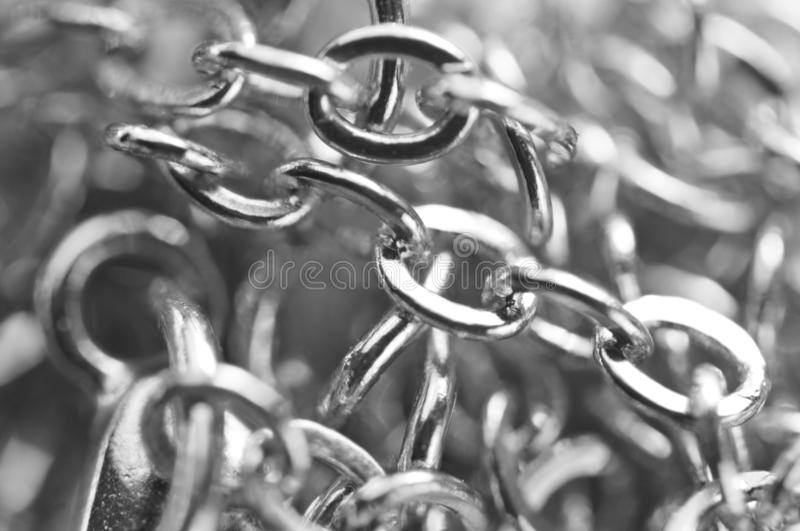 Macro. Black and white photo chain links close-up on full screen royalty free stock image