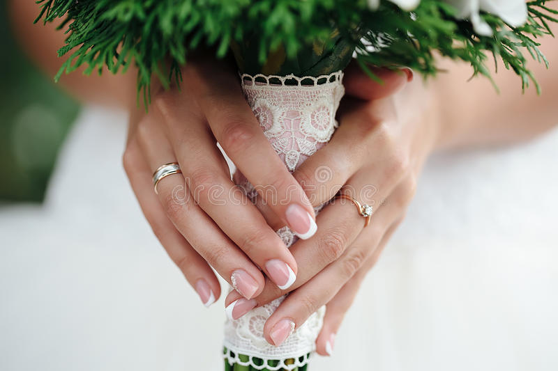Macro bride holding a bouquet stock photo