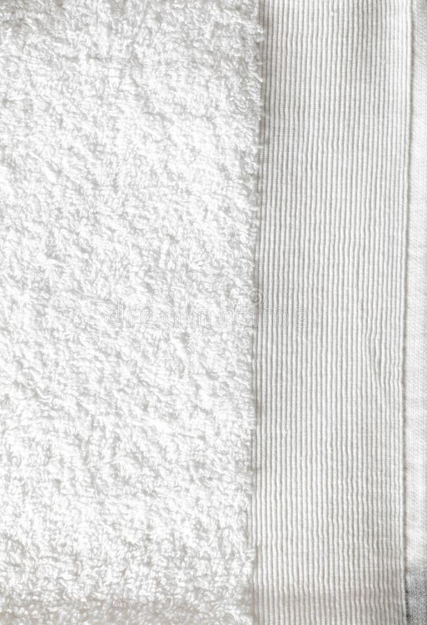 Macro of clean textured white soft cotton towel for cleanliness. Macro of clean white soft cotton towel with beautiful textured border for concept of purity royalty free stock photography