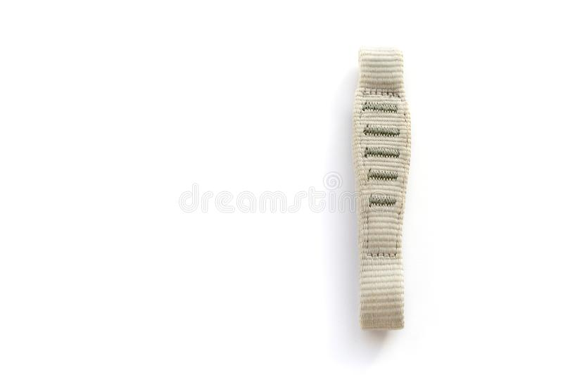 Macro of climbing quickdraw sling express isolated on white background. Used for sport, multi-pitch, and trad climbing royalty free stock photo