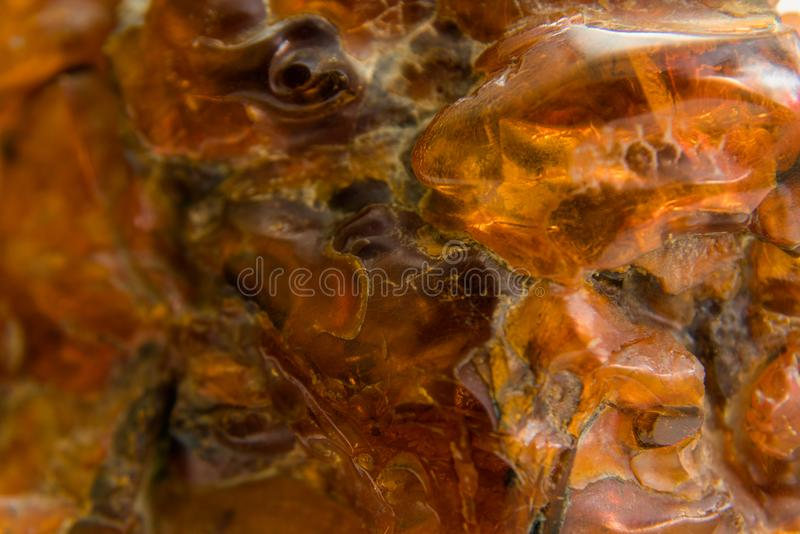Macro Close up of an amber stones from Baltic sea. Multicolored royalty free stock photos