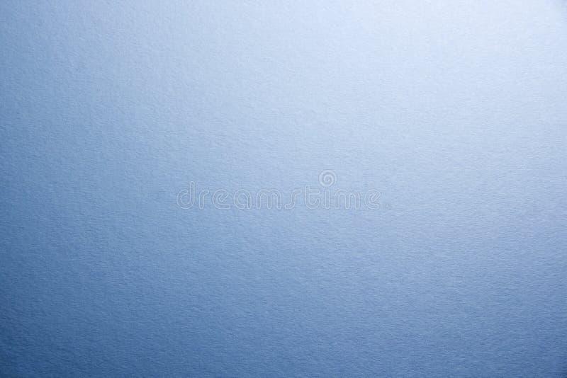 Macro Close-up da textura do papel matte natural Fundo de tonificação azul foto de stock