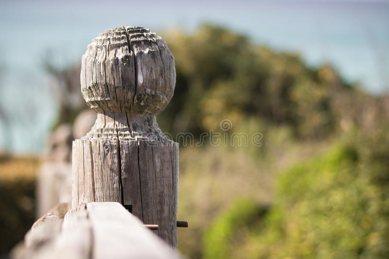 Macro close up detail of wooden fence carved post on atlantic coastline stock images