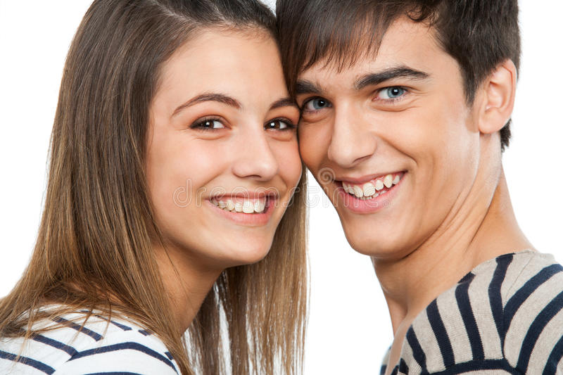 Macro close up of handsome teen couple. Macro close up portrait of handsome teen couple. Isolated on white royalty free stock image