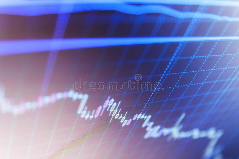 Macro close-up. Market trading screen. Fundamental and technical analysis concept. Stock market quotes on display. Blue screen of. Macro close-up. Market trading stock images