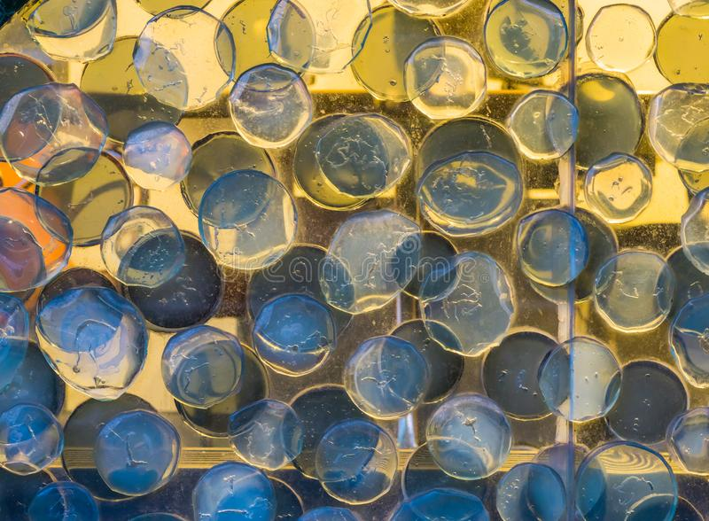 Macro closeup of a beautiful glass art work, round circle shapes pattern, modern architecture background. A macro closeup of a beautiful glass art work, round royalty free stock image