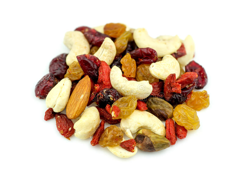 Macro closeup of mixed nuts and dried fruits isolated on white royalty free stock photography