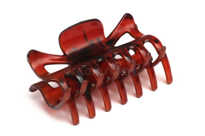 A brown red crocodile hair clip macro photo stock photos