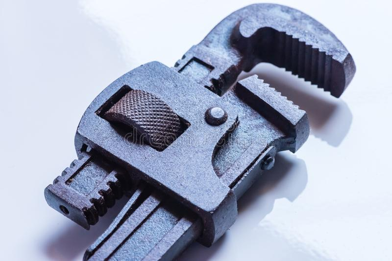 Macro and closeup view of Stained Pipe Wrench. Macro view of stained pipe wrench hand tool in black greasy color stock images