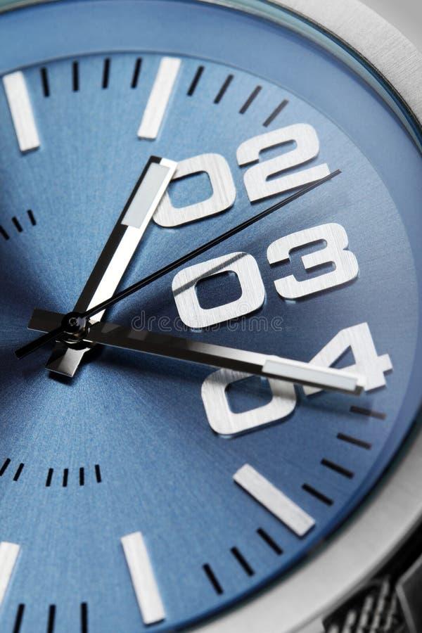 Macro colpo del dettaglio del fronte dell'orologio fotografie stock