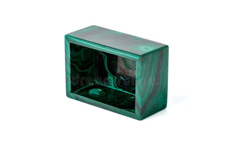 Macro contenitori di malachite su fondo bianco fotografia stock