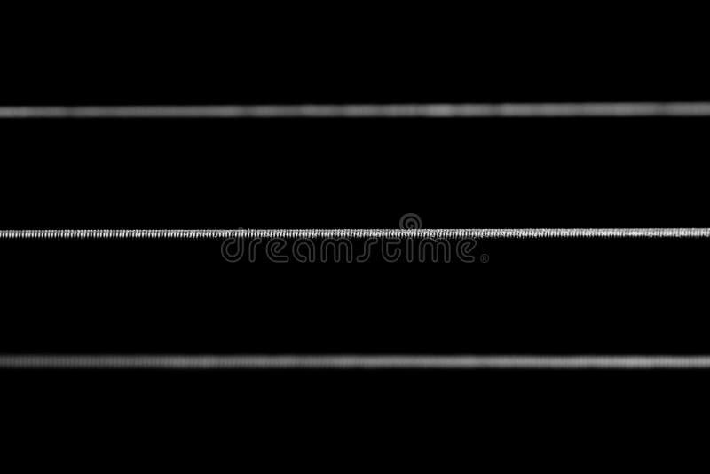 Macro corde della chitarra fotografie stock