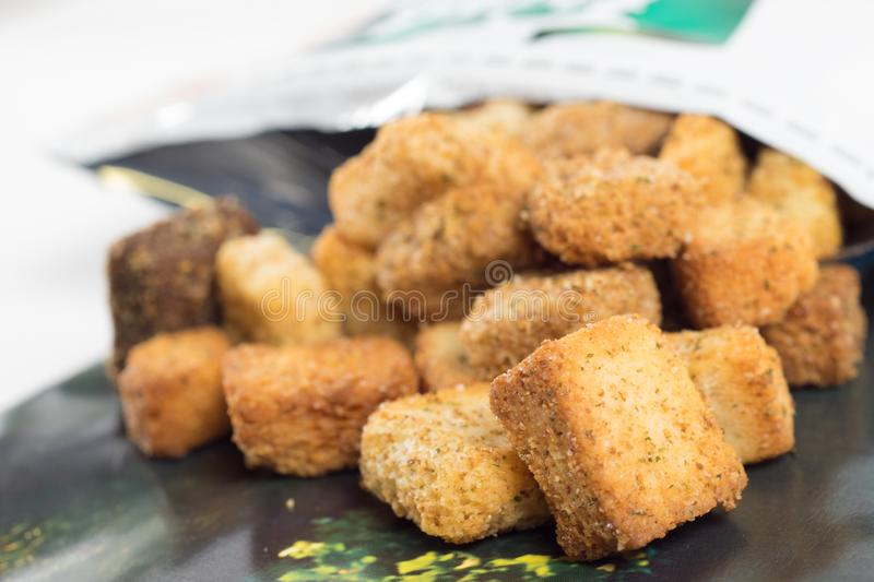 Macro of croutons. Closeup of croûtons. Croutons is a piece of sautéed or rebaked bread, often cubed and seasoned, that is used to add texture and flavor stock photos