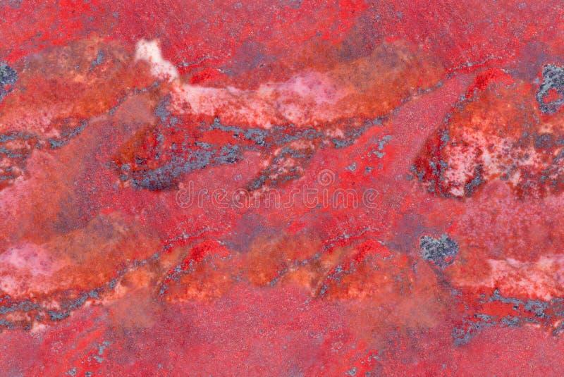 Macro da obscuridade - fundo sem emenda do jaspe vermelho fotografia de stock