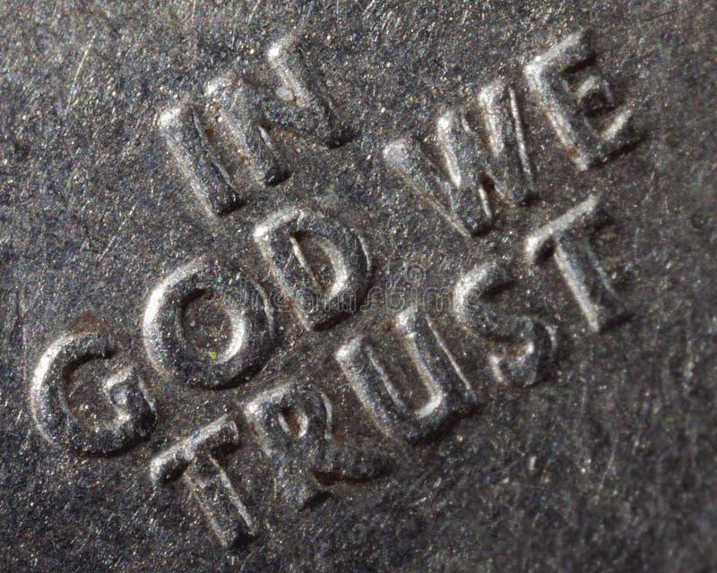 Macro dans Dieu que nous faisons confiance photographie stock libre de droits