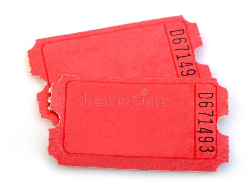 Macro de los boletos rojos aislados imagen de archivo