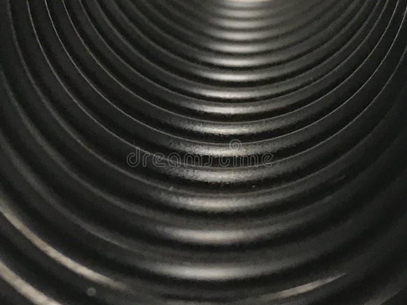 Macro de uma bobina plástica preta imagem de stock royalty free
