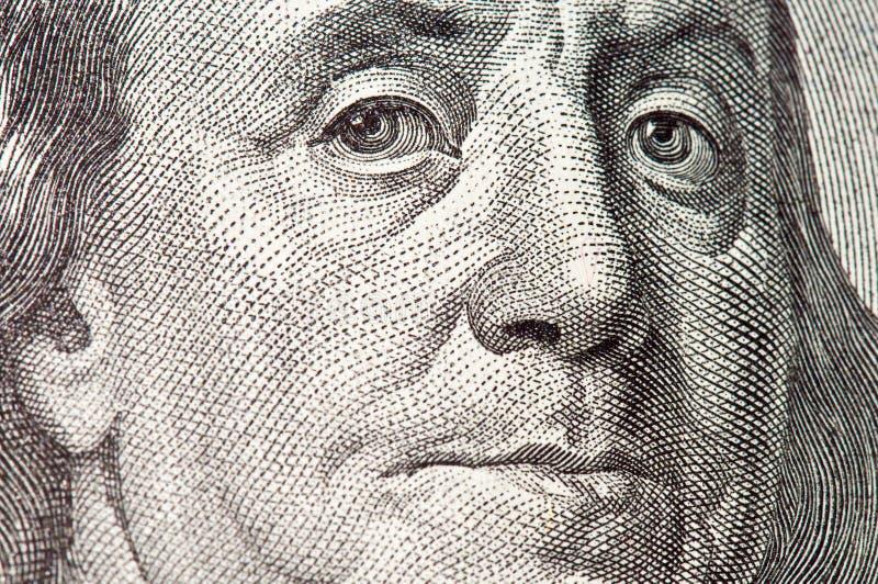 Macro del Benjamin Franklin dalla fattura del dollaro $100 fotografie stock