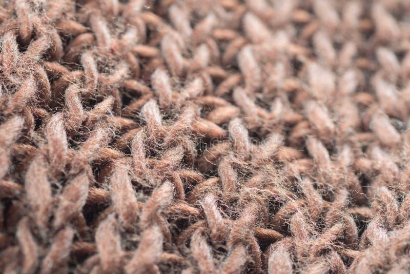 Macro del fondo de la textura de la materia textil de lana de los géneros de punto de Brown fotos de archivo libres de regalías