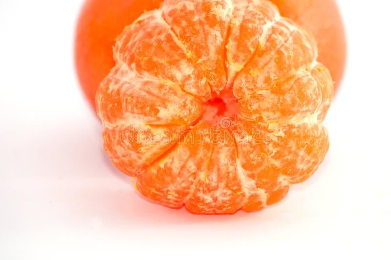 Macro del mandarino, primo piano dolce maturo succoso delle fette del mandarino immagini stock
