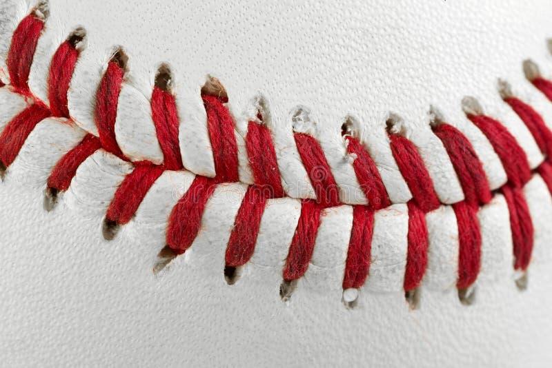 Macro delle cuciture di baseball immagine stock
