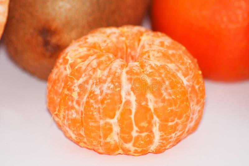 Macro descascado suculento delicioso do close-up do mandarino imagem de stock