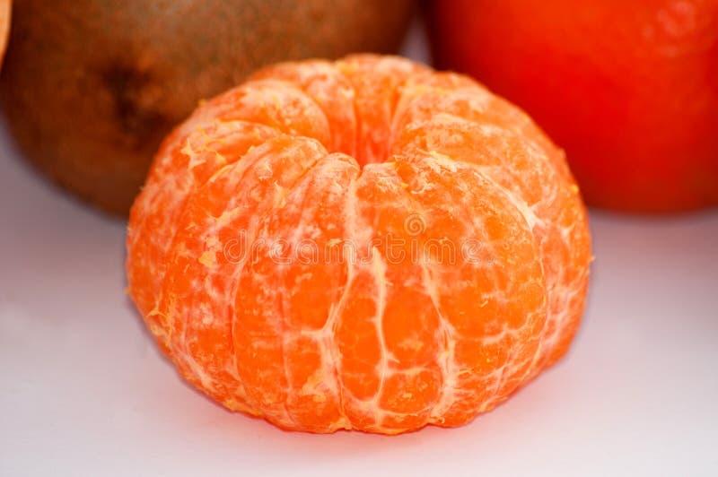 Macro descascado suculento delicioso do close-up do mandarino fotos de stock royalty free