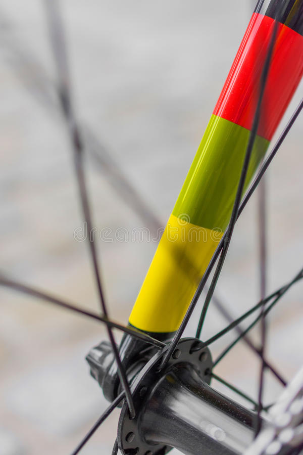 Macro detail of a coloured fixie bike fork royalty free stock image