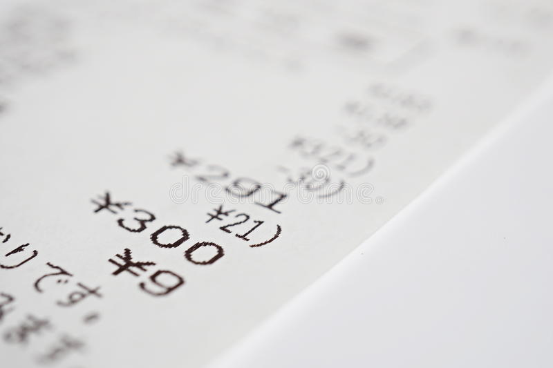 Macro detail of a Japanese paper receipt (white paper bill, sales slip) with a sum of several items stock photos