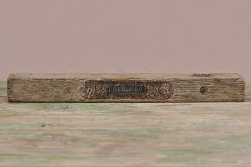 Old spirit level on wooden background stock images