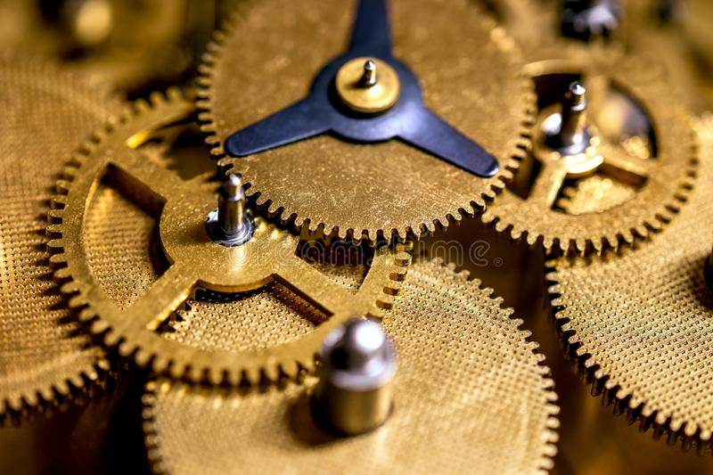 Macro details of gearwheels from a clockwork. Precision and accuracy royalty free stock photo