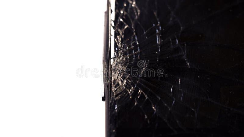 Macro do close-up de vidro escuro quebrado Os elementos do smartphone, tela, sopro de martelo, deixaram cair o smartphone imagens de stock royalty free