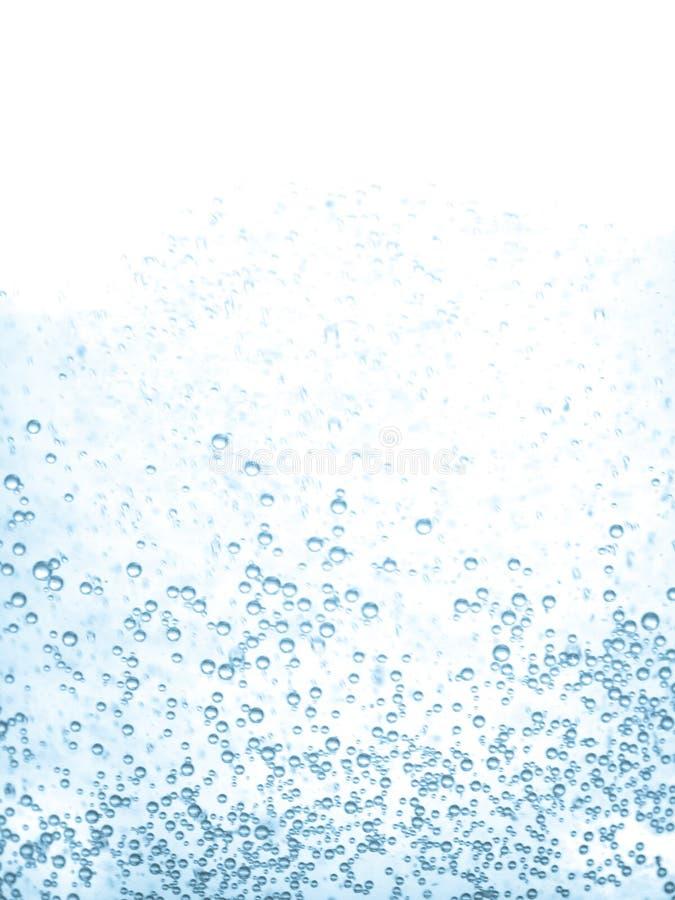 Macro do fundo dos bubles da água azul fotografia de stock
