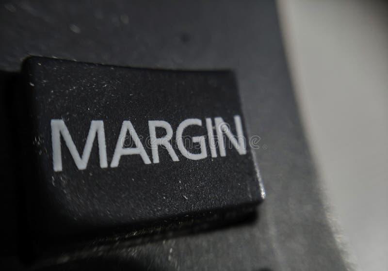 Macro dominante del margen financiero de la calculadora fotos de archivo