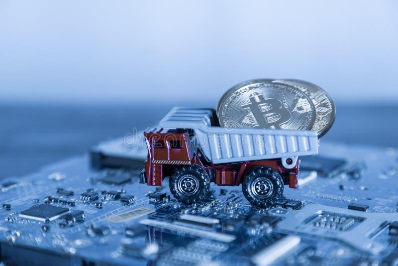 Macro Dump Truck On Blue Computer Motherboard Background. Dumpi. Ng Silver Bitcoin Mining Concept stock photos